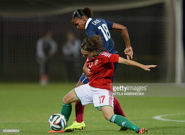 France's forward MarieLaure Delie vies for the ball with Hungary's forward Dóra Zeller during a qualification football match for FIFA World Cup 2015...
