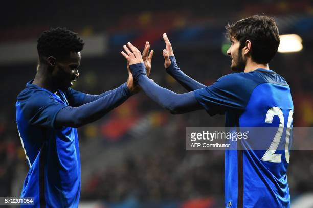 France's forward Martin Terrier is congratulated by France's forward Jonathan Bamba after scoring a goal during the Euro 2019 U21 qualifying football...