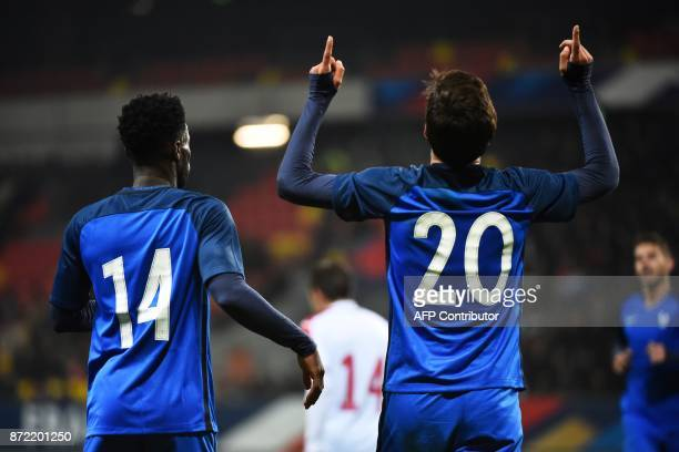 France's forward Martin Terrier reacts next to France's forward Jonathan Bamba after scoring a goal during the Euro 2019 U21 qualifying football...