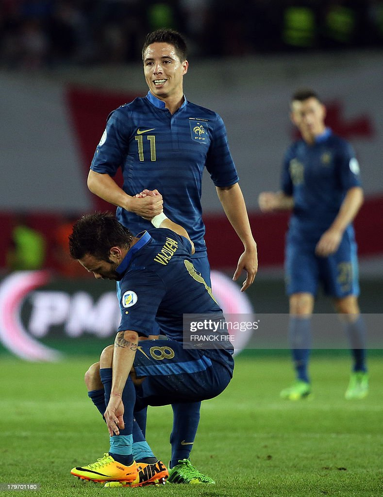 France's forward Mathieu Valbuena and midfielder Samir Nasri (R) react at the end of the FIFA World Cup 2014 qualifying football match Georgia vs France on September 6 2013 at the Boris Paichadze stadium in Tbilisi.