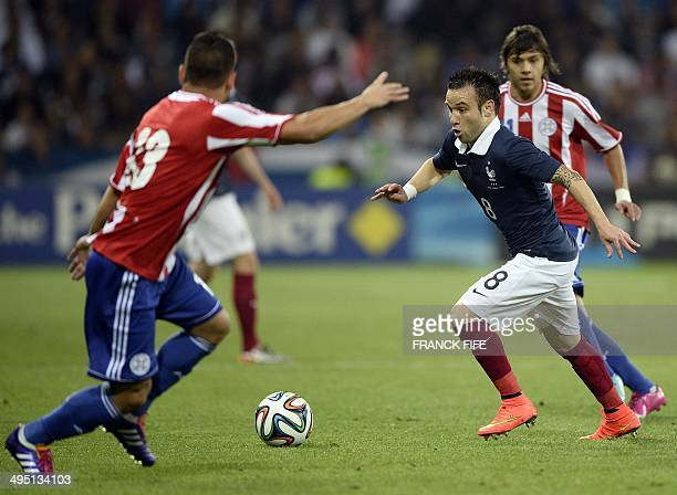 France's forward Mathieu Valbuena controls the ball in front Paraguay's defender Miguel Samudio during a friendly football match between France and...
