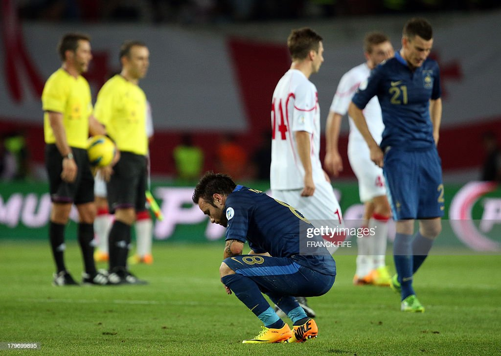 France's forward Mathieu Valbuena (C) reacts at the end of the FIFA World Cup 2014 qualifying football match Georgia vs France on September 6 2013 at the Boris Paichadze stadium in Tbilisi.