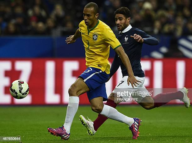 France's forward Nabil Fekir vies with Brazil's defender Joao Miranda during the friendly football match France vs Brazil on March 26 2015 at the...