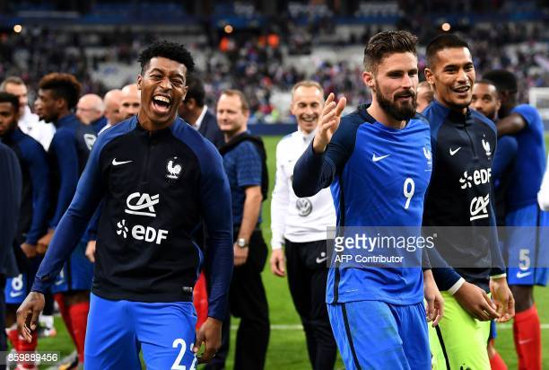 France's forward Olivier Giroud and France's defender Presnel Kimpembe celebrate after winning the FIFA World Cup 2018 qualification football match...