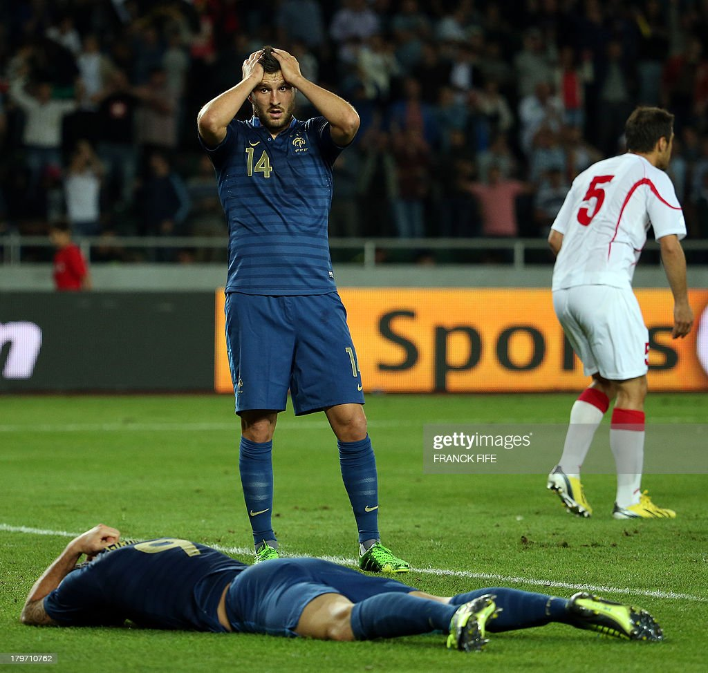 France's forward Olivier Giroud (L) and France's forward Andre Pierre Gignac react after missing a shot during the FIFA World Cup 2014 qualifying football match Georgia vs France on September 6 2013 at the Boris Paichadze stadium in Tbilisi.