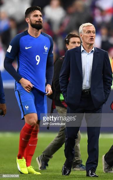 France's forward Olivier Giroud and France's head coach Didier Deschamps react at the end of FIFA World Cup 2018 qualification football match between...