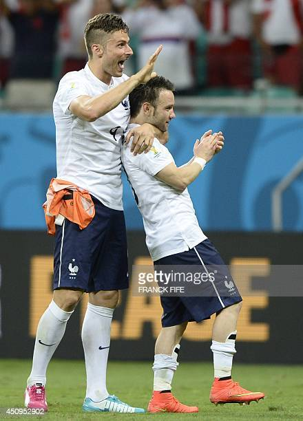 France's forward Olivier Giroud and France's midfielder Mathieu Valbuena celebrate at the end of a Group E football match between Switzerland and...