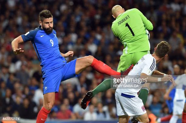 France's forward Olivier Giroud and Luxembourg's goalkeaper Jonathan Joubert go for the ball during the FIFA World Cup 2018 qualifying football match...