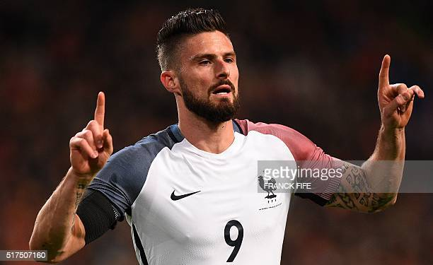 France's forward Olivier Giroud celebrates after scoring a goal during the friendly football match between the Netherlands and France at the...