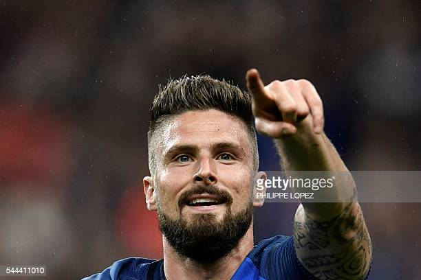 France's forward Olivier Giroud celebrates after scoring a goal during the Euro 2016 quarterfinal football match between France and Iceland at the...