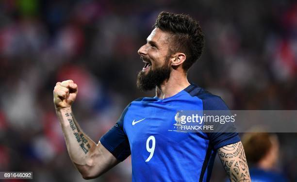 France's forward Olivier Giroud celebrates after scoring a goal during the friendly football match France vs Paraguay on June 2 2017 at the Roazhon...