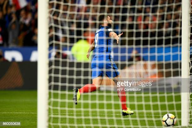 France's forward Olivier Giroud celebrates after scoring a goal during the FIFA World Cup 2018 qualification football match between France and...