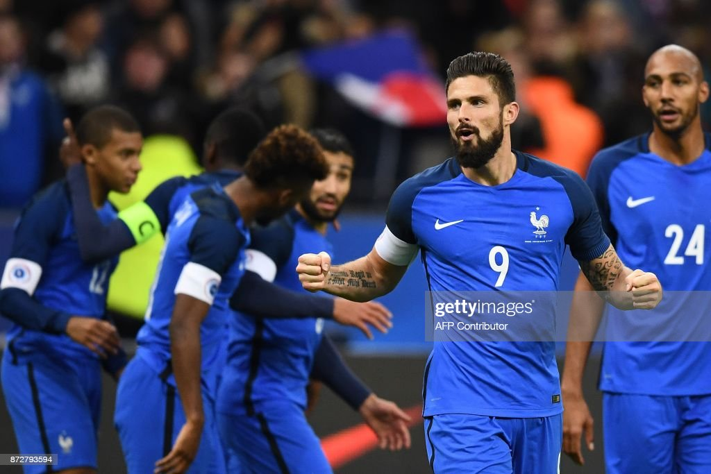 TOPSHOT - France's forward Olivier Giroud (C) celebrates after scoring a goal during the friendly football match between France and Wales at the Stade de France stadium, in Saint-Denis, on the outskirts of Paris, on November 10, 2017. /