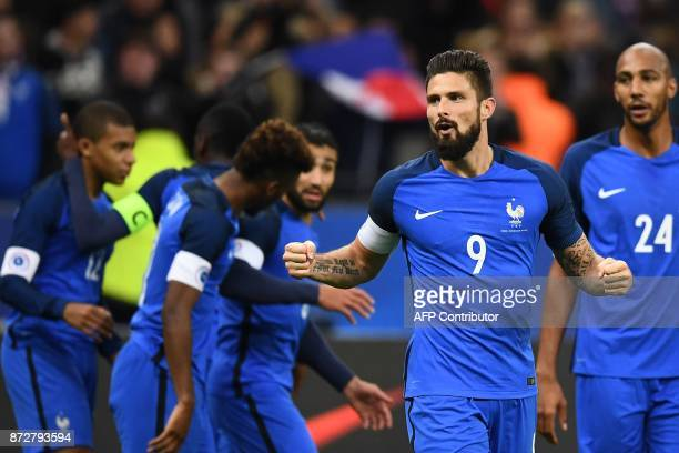 TOPSHOT France's forward Olivier Giroud celebrates after scoring a goal during the friendly football match between France and Wales at the Stade de...