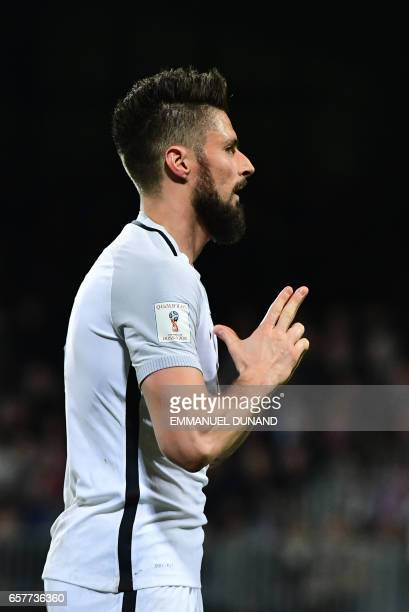 France's forward Olivier Giroud celebrates after scoring during the World Cup 2018 football qualification match between Luxembourg and France on...