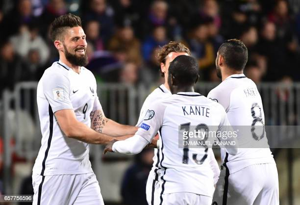 France's forward Olivier Giroud celebrates after scoring during the FIFA World Cup 2018 qualifying football match Luxembourg vs France on March 25...