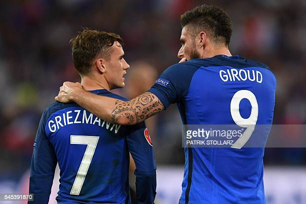 TOPSHOT France's forward Olivier Giroud celebrates with France's forward Antoine Griezmann after he scored a penalty shot giving France the first...