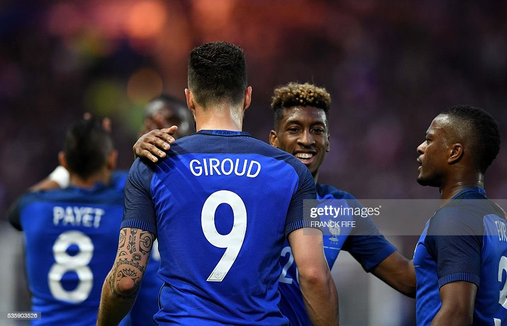 France's forward Olivier Giroud (L) celebrates with his teammates forward Kingsley Coman (C) and defender Patrice Evra (R) after scoring a goal during the International friendly football match between France and Cameroon at the Beaujoire stadium, in Nantes, western France, on May 30, 2016 as part of the French team's preparation for the upcoming Euro 2016 European football championships. / AFP / FRANCK