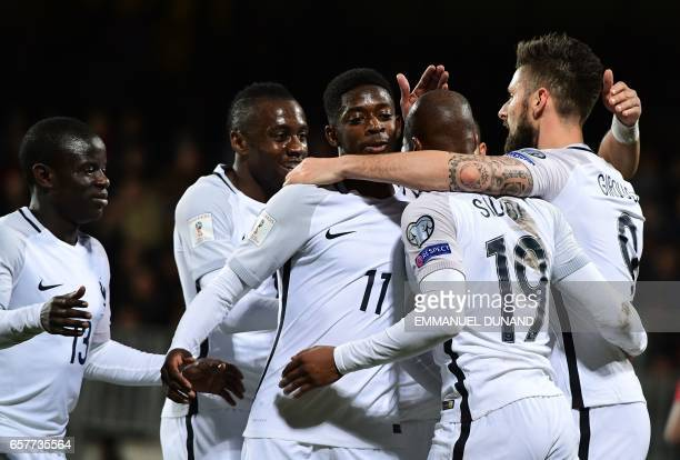 France's forward Olivier Giroud celebrates with teamates after scoring during the FIFA World Cup 2018 qualifying football match between Luxembourg...