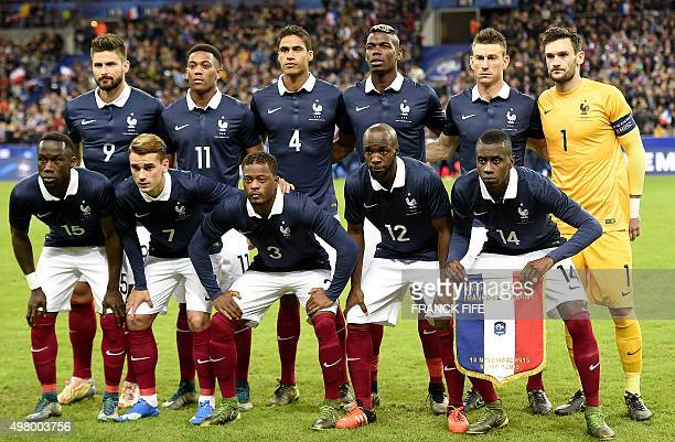 France's forward Olivier Giroud forward Anthony Martial defender Raphael Varane midfielder Paul Pogba defender Laurent Koscielny and goalkeeper Hugo...