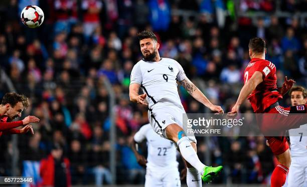 France's forward Olivier Giroud heads the ball during the FIFA World Cup 2018 qualifying football match between Luxembourg and France on March 25 at...