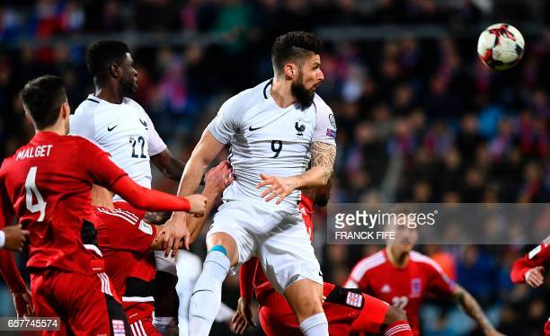 France's forward Olivier Giroud heads the ball during the FIFA World Cup 2018 qualifying football match Luxembourg vs France on March 25 2017 at Josy...