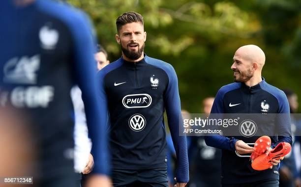 France's forward Olivier Giroud jokes with France's defender Christophe Jallet before a training session in ClairefontaineenYvelines on October 2 as...
