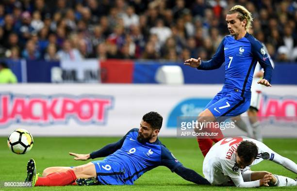 France's forward Olivier Giroud kicks the ball next to France's forward Antoine Griezmann during the FIFA World Cup 2018 qualification football match...