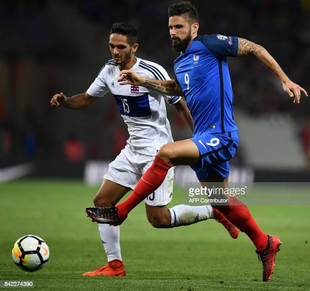 France's forward Olivier Giroud outruns Luxembourg's defender Aldin Skenderovic during the FIFA World Cup 2018 qualifying football match France vs...
