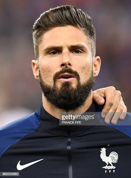 France's forward Olivier Giroud poses ahead of the FIFA World Cup 2018 qualification football match between France and Belarus at the Stade de France...