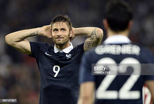 France's forward Olivier Giroud reacts after missing a goal opportunity during the friendly football match between France and Paraguay on June 1 2014...