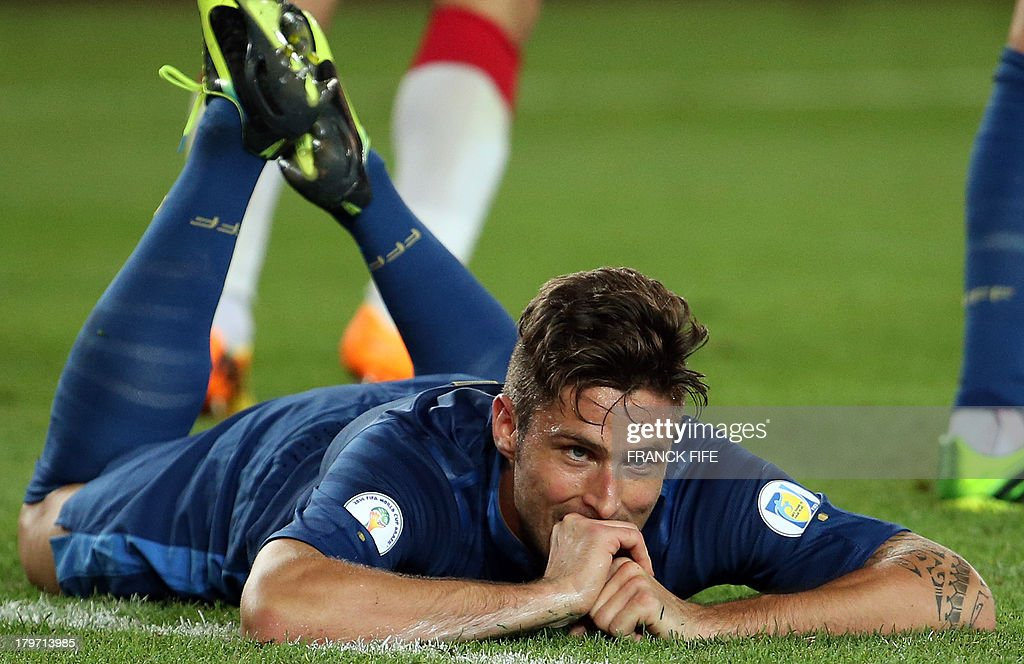 France's forward Olivier Giroud reacts after missing a shot during the FIFA World Cup 2014 qualifying football match Georgia vs France on September 6 2013 at the Boris Paichadze stadium in Tbilisi.