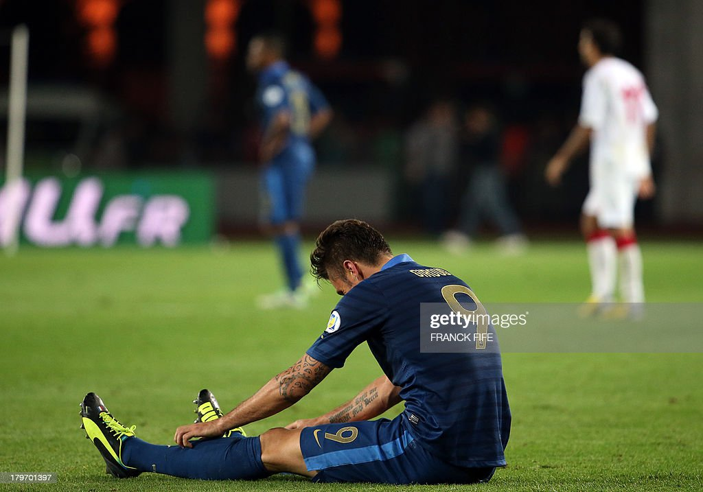 France's forward Olivier Giroud reacts at the end of the FIFA World Cup 2014 qualifying football match Georgia vs France on September 6 2013 at the Boris Paichadze stadium in Tbilisi.