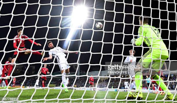 France's forward Olivier Giroud scores a goal during the FIFA World Cup 2018 qualifying football match Luxembourg vs France on March 25 2017 at the...