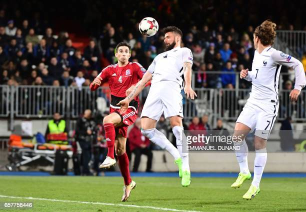 France's forward Olivier Giroud scores the third goal during the FIFA World Cup 2018 qualifying football match Luxembourg vs France on March 25 2017...