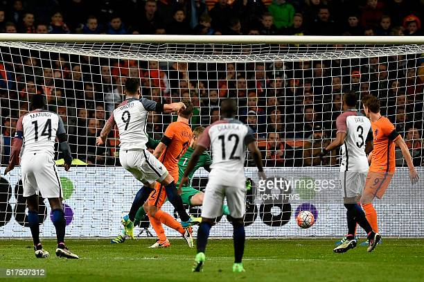 France's forward Olivier Giroud shoots and scores a goal during the friendly football match between the Netherlands and France at the Amsterdam ArenA...