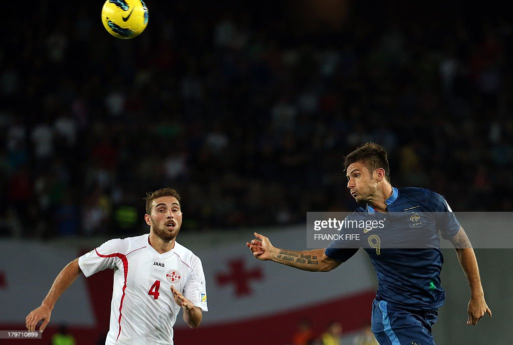 France's forward Olivier Giroud (R) vies with Georgia's defender Guram Kashia during the FIFA World Cup 2014 qualifying football match Georgia vs France on September 6 2013 at the Boris Paichadze stadium in Tbilisi.