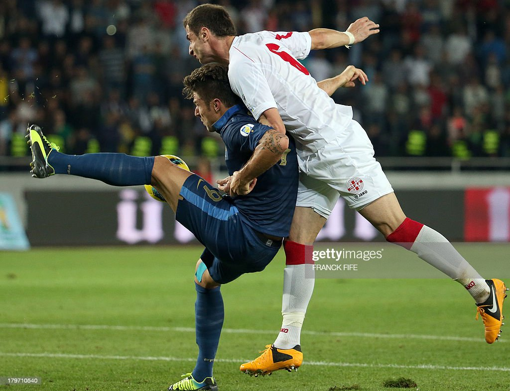 France's forward Olivier Giroud (L) vies with Georgia's midfielder Akaki Khubutia during the FIFA World Cup 2014 qualifying football match Georgia vs France on September 6 2013 at the Boris Paichadze stadium in Tbilisi.