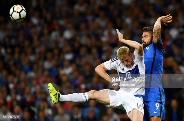 France's forward Olivier Giroud vies with Luxembourg's defender Laurent Jans during the FIFA World Cup 2018 qualifying football match France vs...