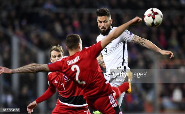 France's forward Olivier Giroud vies with Luxembourg's defender Maxime Chanot during the FIFA World Cup 2018 qualifying football match between...