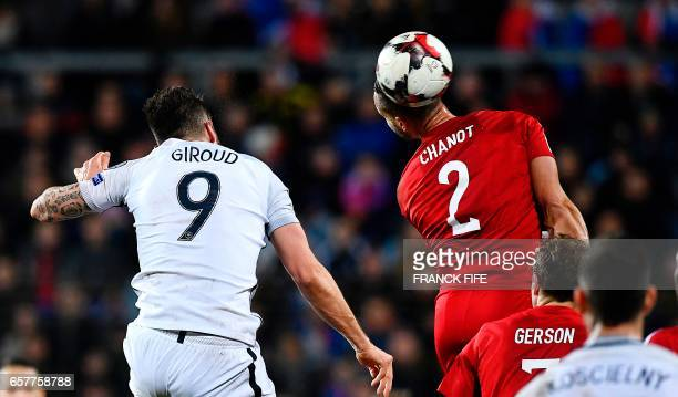 France's forward Olivier Giroud vies with Luxembourg's defender Maxime Chanot during the FIFA World Cup 2018 qualifying football match Luxembourg vs...