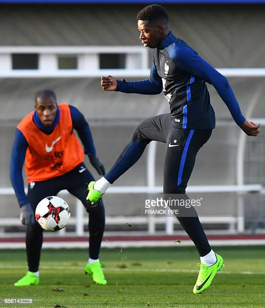 France's forward Ousmane Dembele controls the ball next to midfielder Blaise Matuidi during a training session in Clairefontaine near Paris on March...