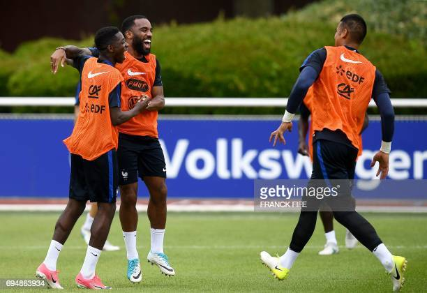 France's forward Ousmane Dembele France's forward Alexandre Lacazette and France's goalkeeper Alphonse Areola react at the end of a training session...