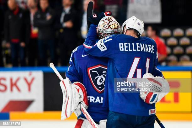 France's forward PierreEdouard Bellemare celebrates with his teammate France's goalkeeper Cristobal Huet after France won the IIHF Men's World...