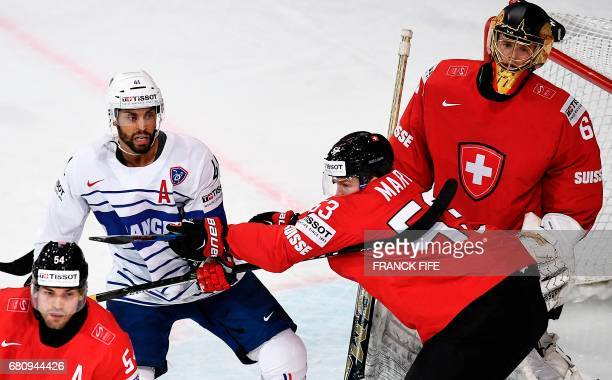 France's forward PierreEdouard Bellemare vies with Switzerland's defender Christian Marti during the IIHF Men's World Championship group B ice hockey...