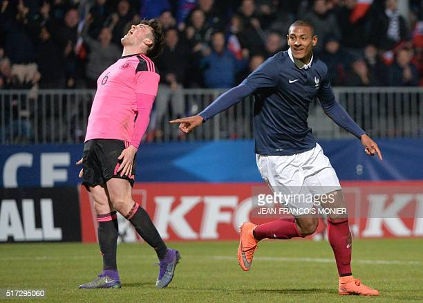 France's forward Sebastien Haller celebrates after scoring during the UEFA Euro 2017 U21 Championship qualifying football match between France and...