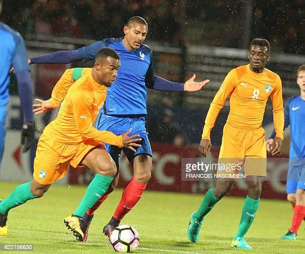 France's forward Sebastien Haller vies with Ivory Coast's captain Digho Habib Maiga during the friendly international U21 football match between...
