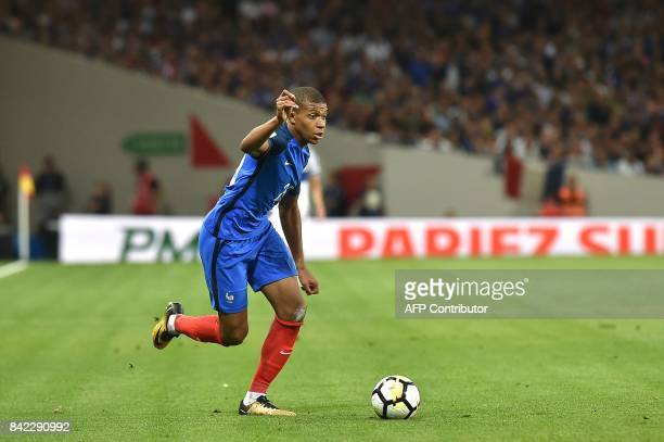 France's forwards Kylian Mbappe runs with the ball during the FIFA World Cup 2018 qualifying football match France vs Luxembourg on September 3 2017...