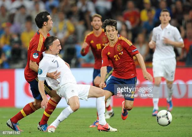 France's Franck Ribery battles for the ball with Spain's Sergio Busquets and David Silva