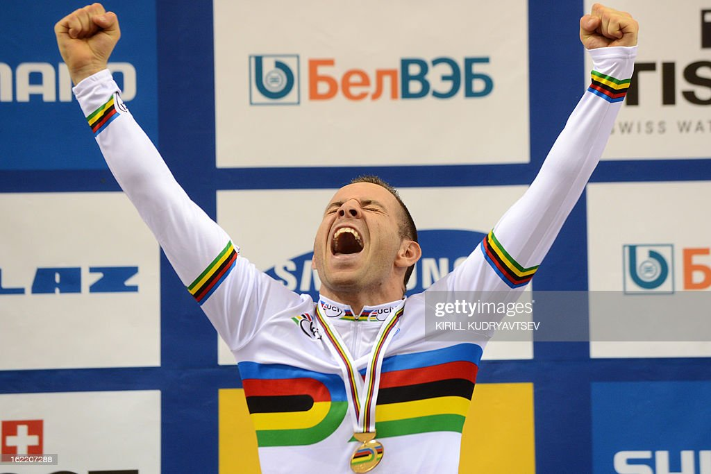 France's Francois Pervis celebrates his victory on the podium of the men's time trial of UCI Track Cycling World Championships in Minsk on February 20, 2013.